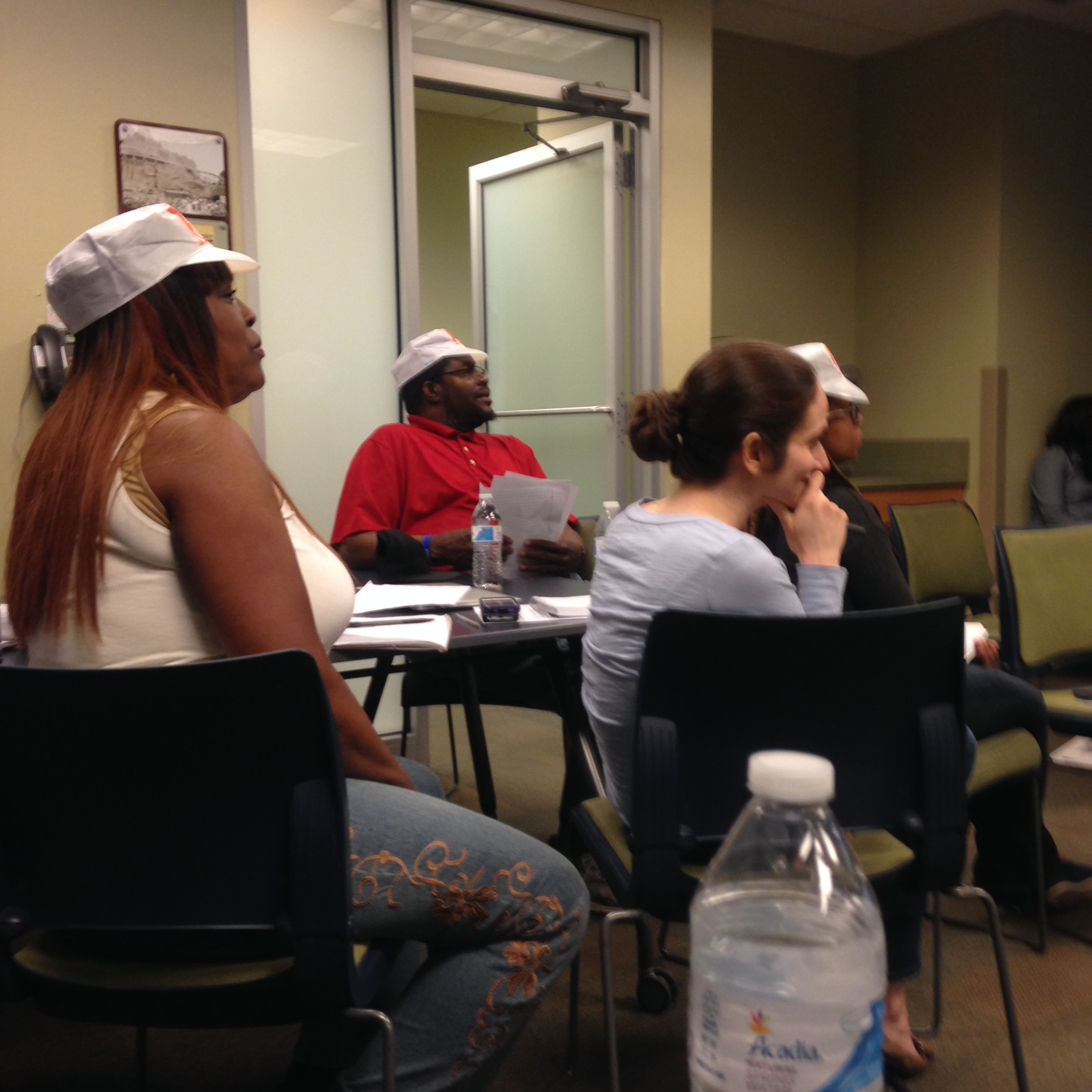 Listening to one another present during Trainers' Bootcamp