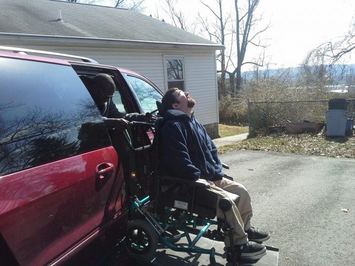 Mitchell using a van lift