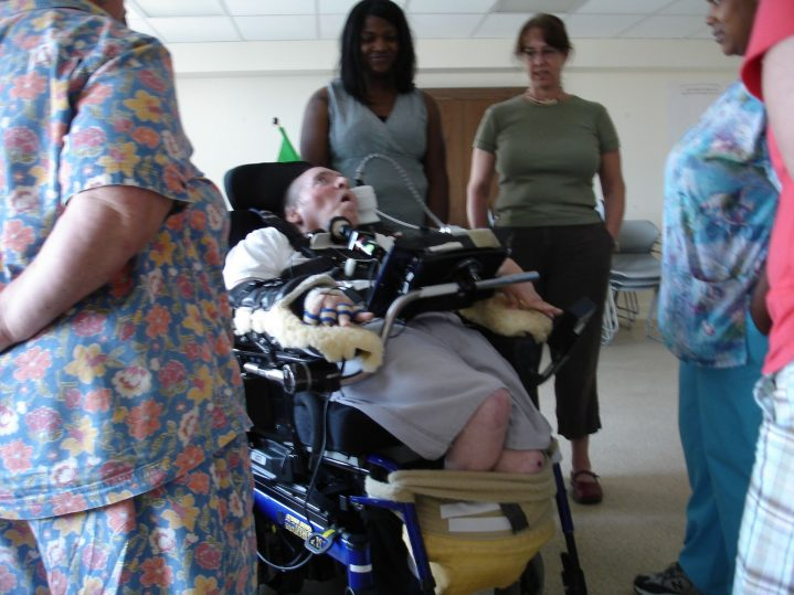 Woman in wheelchair using a communication device