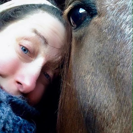 Jessica head to head with a horse