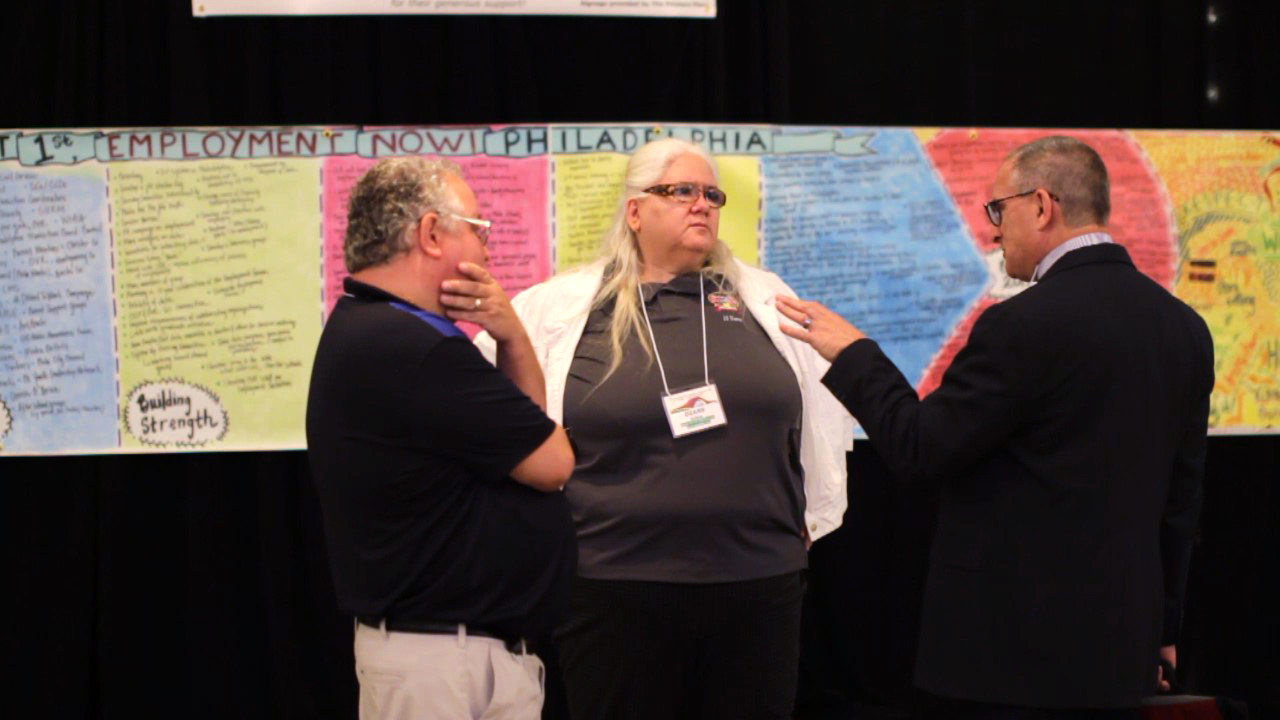 Joe & Diane talk with Len during the Symposium