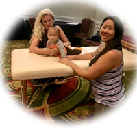 Massaging a baby at APSE