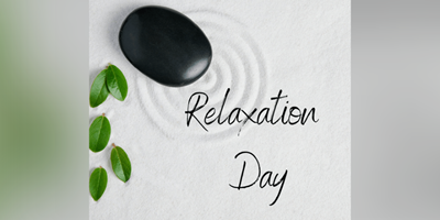"Zen garden with Pebble and leaf for relax and meditation. with the words ""Relaxation Day"""